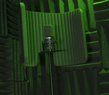 a microphone ready to record in a portable vocal isolation booth