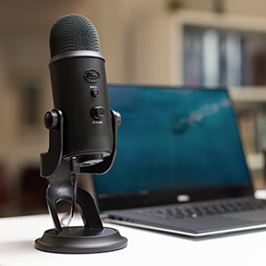 blue yeti on the desk dictating